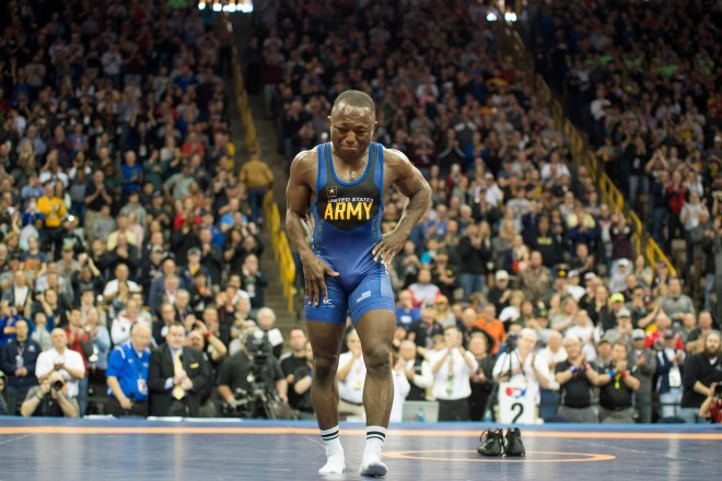 "Former two-time Olympian and Army wrestler Spenser Mango, of St. Louis, walks off the mat retiring from wrestling after losing to Jesse Thielke, of Germantown, Wisconsin, in the Semi Finals match of 59 KG in greco roman during the US Wrestling Olympic Team Trails Saturday, April 9, 2016, at Carver Hawkeye Arena in Iowa City, Iowa. ""When I first started trying to take my shoes off I thought I was just going to take them off real quick and get out of there because I knew I wasnÕt going to be able to hold my emotions back. I heard everybody cheering for me. You know, you go through your whole career I guess hoping that when youÕre done you feel like youÕre appreciated and the crowd was great,"" said Mango after his match. Mango competed on the US Olympic team in 2008 and 2012. Jeff Brown/The Hawk Eye"