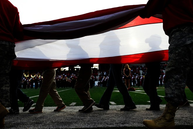 Boys scouts and members of the military bring out a flag before the national anthem in an NCAA college football game, Saturday, Nov. 5, 2016, in Bowling Green, Ky.