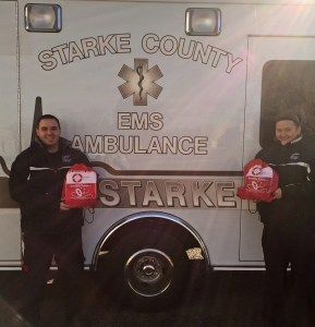Travis Clary and Candice Austin show off the pet oxygen masks Starke County EMS recently obtained through a grant.