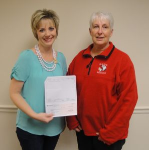 Kankakee Valley REMC Director of Marketing and Communications Amanda Steeb presents the grant to Starke County Fair Board Treasurer Beverly Albright