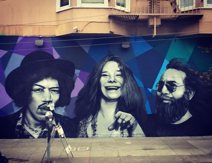 Jimmy, Janice, and Jerry: Mural on a street off Haight. Jimmy's smoking, she's laughing, he's just bearded.