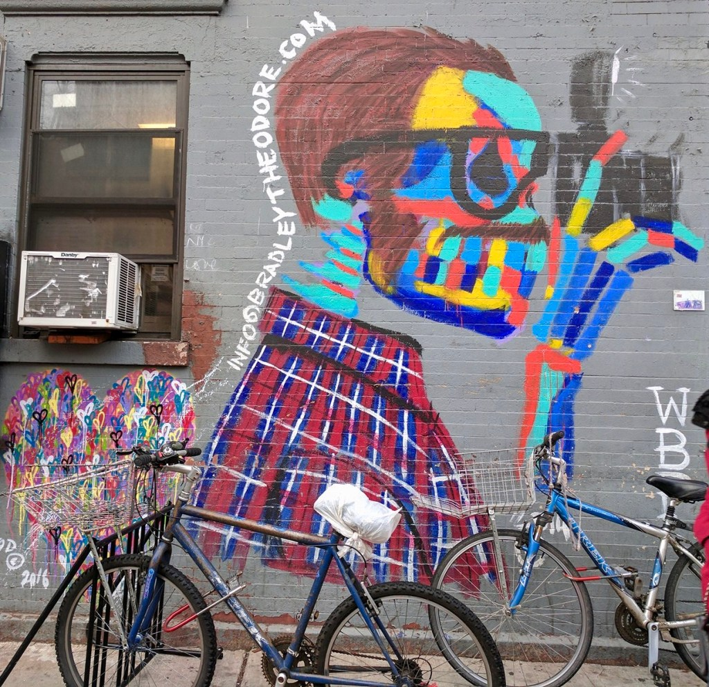 Mural of Hipster Skeleton in Primary Colors taking a photo, plus a heart built of hearts