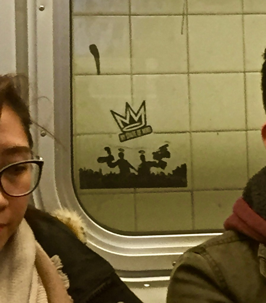 NY State of Mind sticker as seen through a subway window
