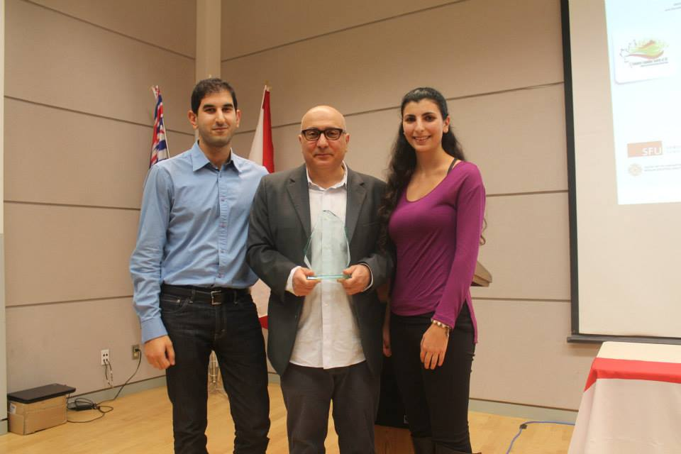 melanie mark rawi and plaque