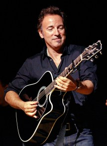 """** FILE ** In this Nov. 5, 2008 file photo, Bruce Springsteen plays his guitar in New York. On Wednesday, Feb. 4 , 2009 Springsteen said he was furious with Ticketmaster calling its selling practices a """"conflict of interest"""" after complaints that the vendor was redirecting fans to a more expensive ticket seller owned by the company. (AP Photo/Stuart Ramson, file) NY128"""