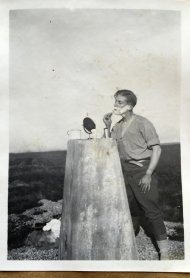 An alternative use for the trig pillar: At the time the trig pillar was devised by Brigadier Martin Hotine, it was intended to provide a solid base for the theodolites used by the survey teams to improve the accuracy of the readings obtained. This member of the surveying team found an alternative use!