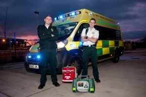 Sam - Ben in front of ambulance at dusk