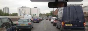 Ambulance making progress through busy traffic