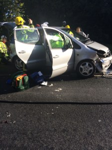 Road blocked by two-car crash 2 24-09-15