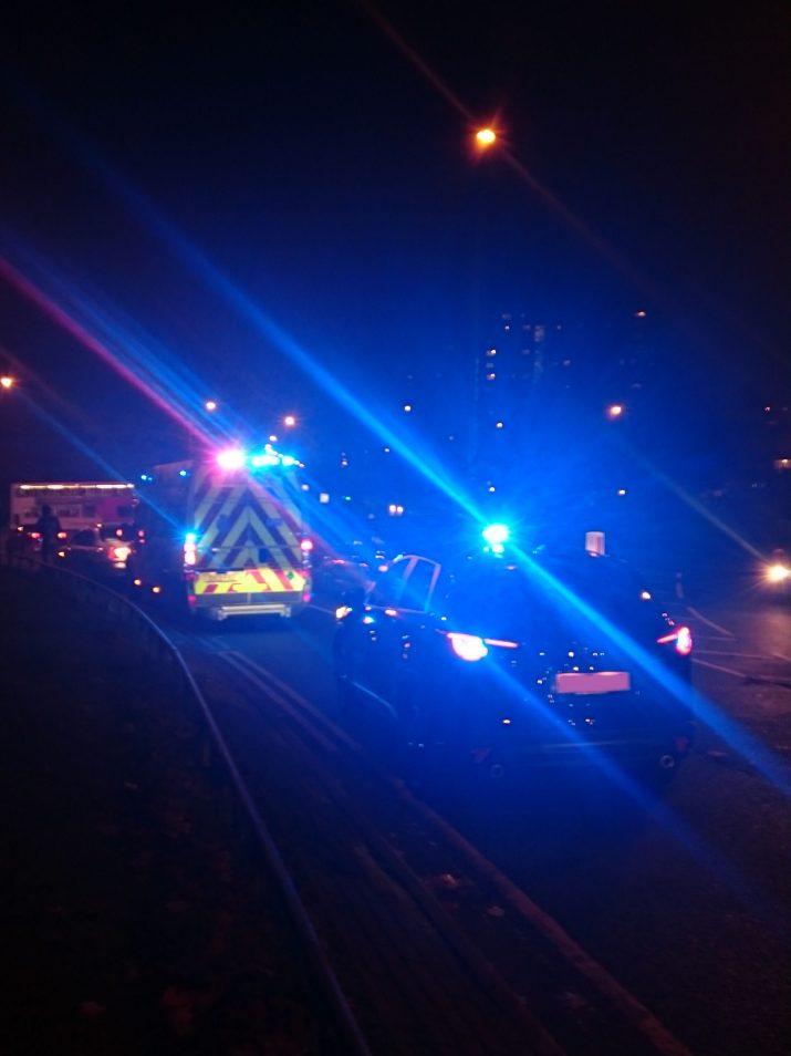 Ambulance and Officer Car at night