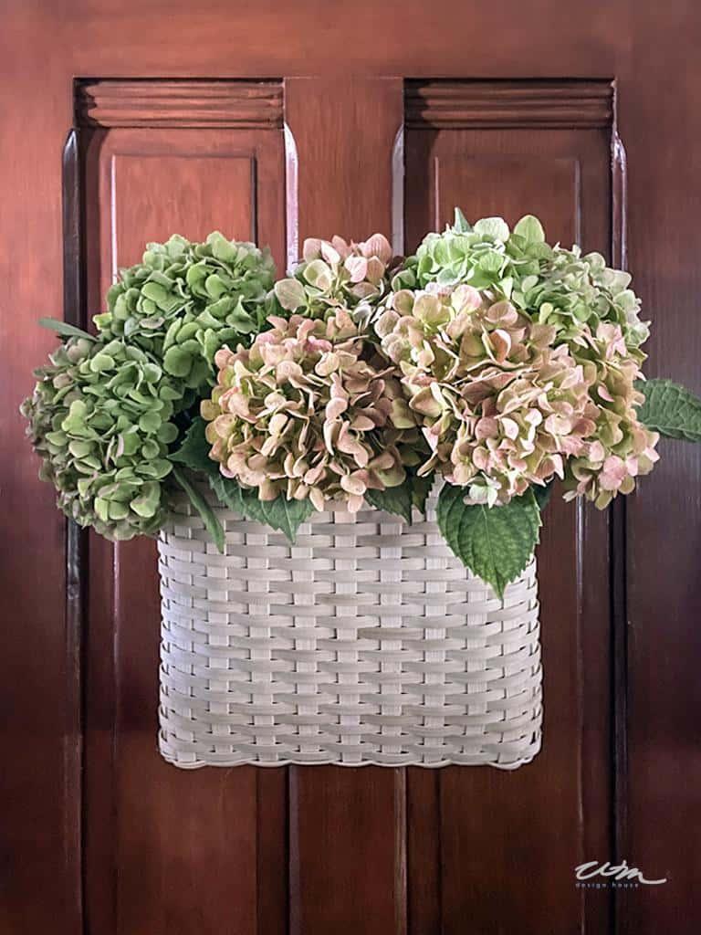 basket of flowers on door
