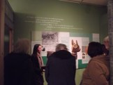 Michelle Scott talking to WMES members in the 'Gifts for the Gods' exhibition