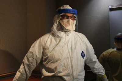 An Orlando health volunteer demonstrates the kind of gear used by healthcare workers when treating Ebola patients