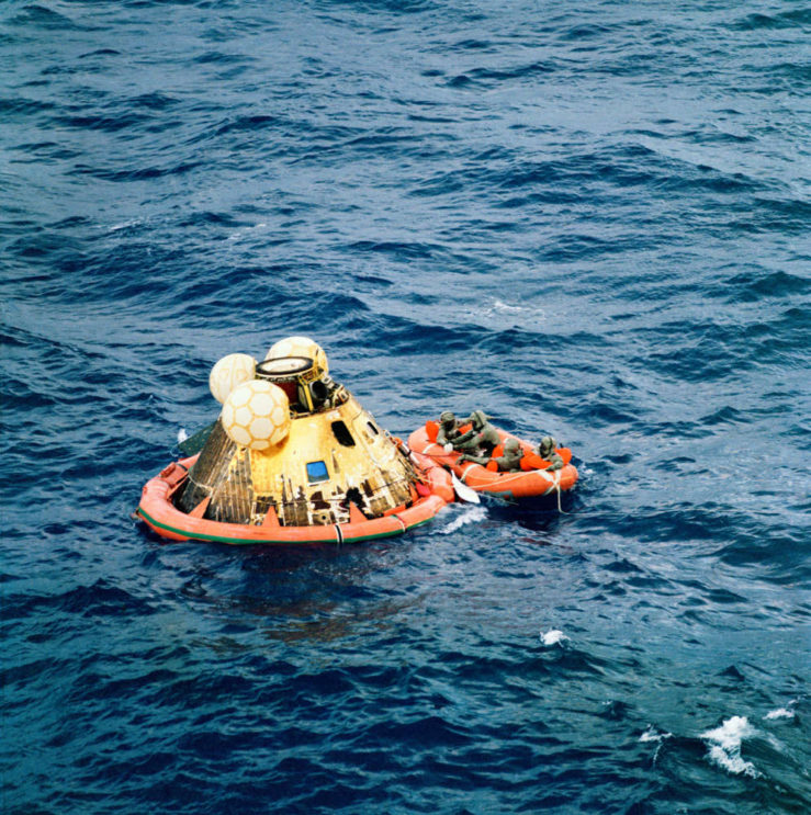The crew of Apollo 11 is picked up after its splashdown.