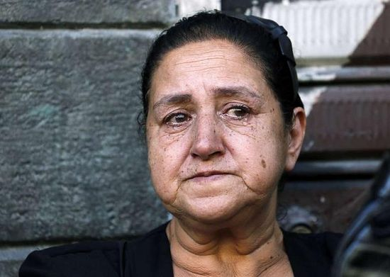A woman cries at the funeral of Christians killed in Maaloula.