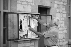 Man pinning information to a notice board