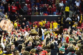 Terp fans storm the court after the victory over Wisconsin. (Courtesy of Emily Olsen)