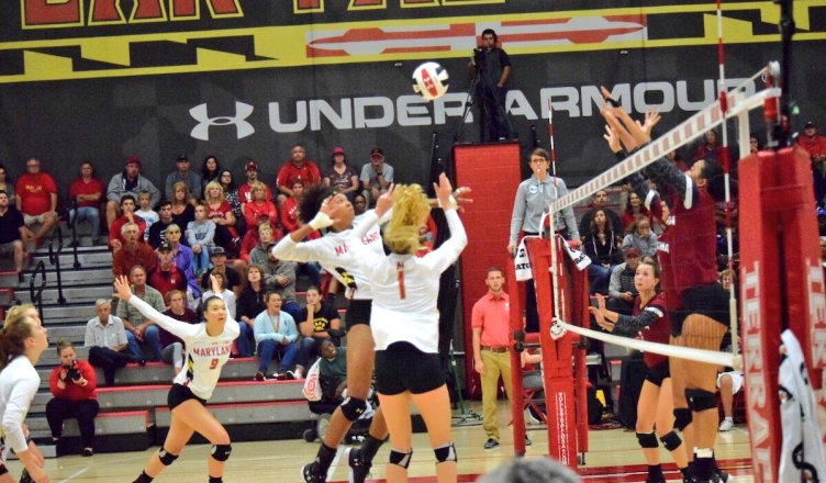 Nicole Alford sets a ball for Rainelle Jones. (Photo courtesy of UMD Athletics).