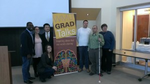 Dean Sue Stapleton stands with the first GradTalks presenters