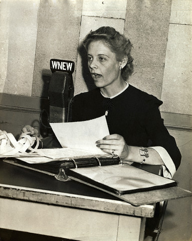 ca. 1940s, New York, New York, USA --- Alice Marble, top ranking woman tennis player, who has just signed a contract with WNEW, New York radio station, for a series of weekend football forecasts and comment on college games during the fall season.  She will be heard each Friday and Saturday at 7:45 PM.  Heretofore, her radio experience has been limited to singing and guest appearances. --- Image by © Underwood & Underwood/CORBIS