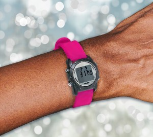 WobL+ watch in pink shown on a small wrist.