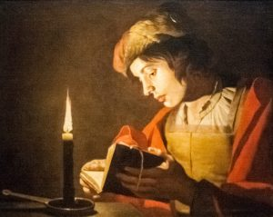 Stom_-_A_Young_Man_Reading_at_Candlelight