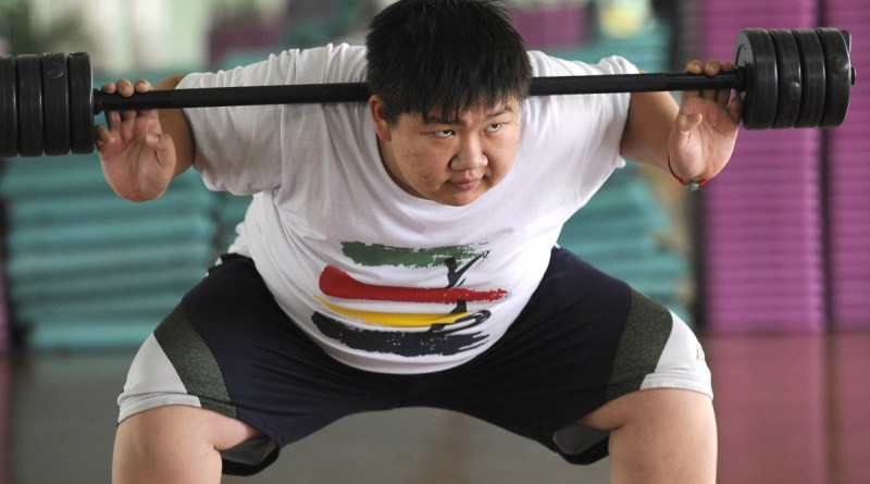 A man works out in Beijing. China's public health crisis could cost the country trillions of dollars. Photo- AFP