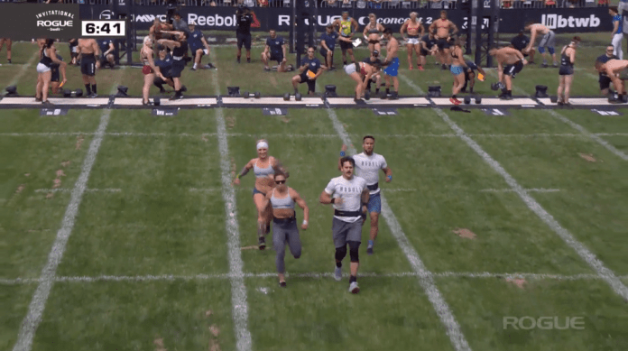 CrossFit Invictus Back Bay with Craig Kenney and Kelsey Kiel race to the finish line of the snatch and press event.