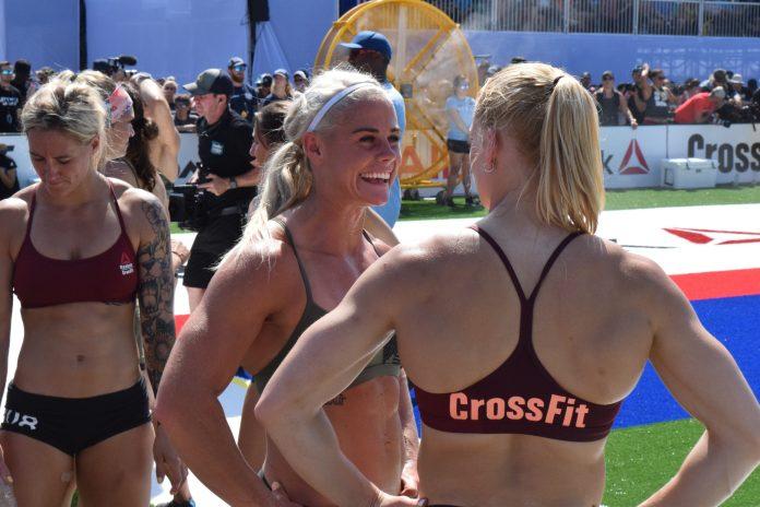 Annie Thorisdottir and Sara Sigmundsdottir talk between heats of the Sprint event at the 2019 CrossFit Games