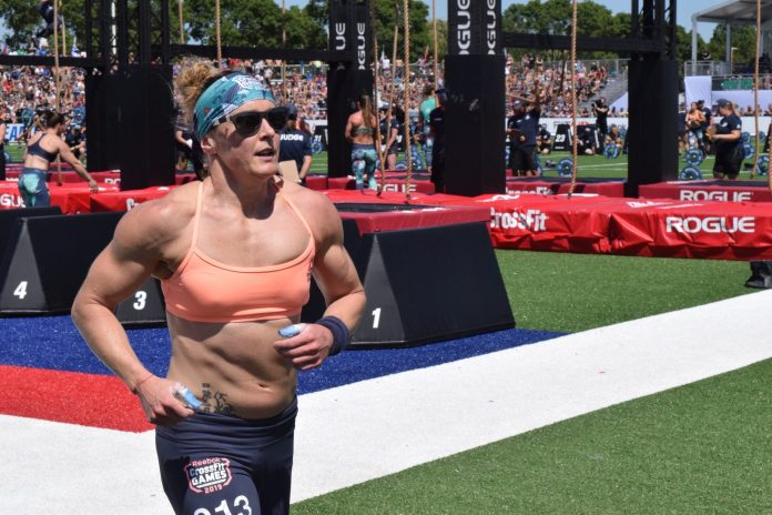 Sam Briggs runs before her legless rope climbs at the 2019 CrossFit Games