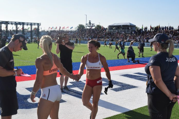 Tia-Clair Toomey high-fives Katrin Davidsdottir after an event at the 2019 CrossFit Games.