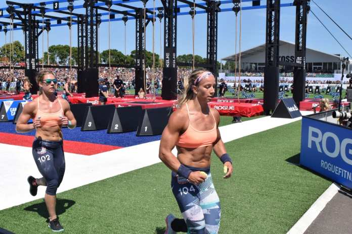 Brooke Wells chases Amanda Barnhart out of the stadium at the 2019 CrossFit Games