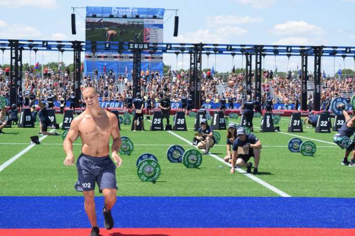 Cole Sager crosses the finish line during the first event of the 2019 CrossFit Games