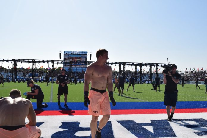Samuel Kwant crosses the finish line in the second event fo the 2019 CrossFit Games