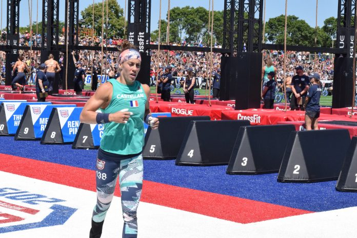 Carole Castellani takes a lap between rounds of legless rope climbs at the 2019 CrossFit Games