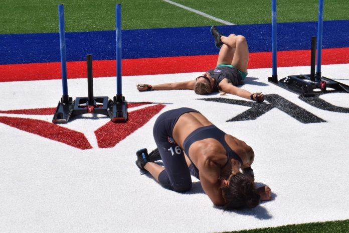 Anna Fragkou collapses after the Sprint Bicouplet event at the 2019 CrossFit Games.