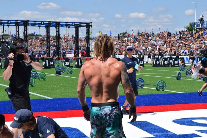 James Newbury watches other competitors finish the first event of the 2019 CrossFit Games
