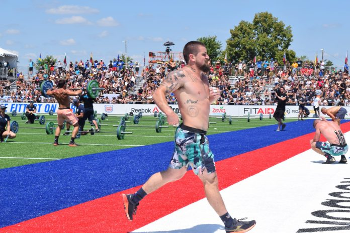 Matt Mcleod crosses the finish line of an event at the 2019 CrossFit Games