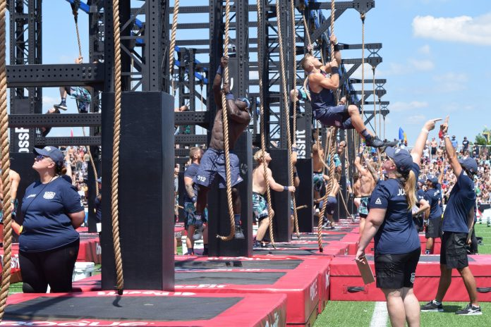 Chandler Smith completes a legless rope climb at the 2019 CrossFit Games