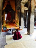 Buddhist Monk Praying at Angkor Wat
