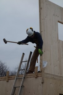 Hammering the wall into the exact position