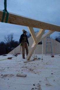 The posts and beam are assembled in what will be the attic