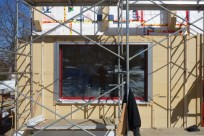 A completed window section with trim, Multitherm 220 top-layer and studs for siding