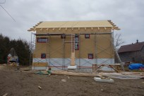 With the clouds coming in, the roof insulation is finished