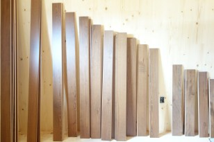 Beech planks sorted by size & lined up against the wall