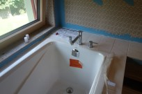 Bath tub and faucet installed