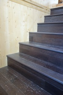 Gingerbread hickory stairs contrast with natural spruce walls