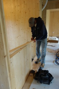 Chris trims the half wall on the upstairs landing