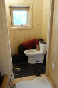Alfredo installs the upstairs toilet