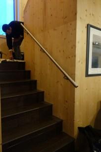 The lower steel handrail